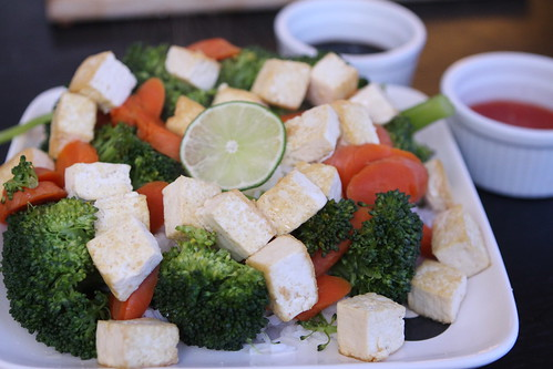 Pan Fried Tofu with Steamed Broccoli, Carrots, Rice, Sweet Chili Dipping Sauce, and Soy Sauce