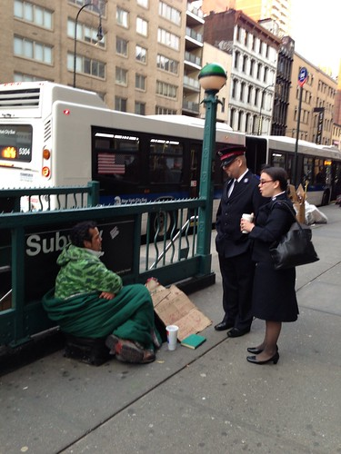 Salvation Army workers with homeless man