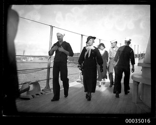 United States Navy sailors with female visitors on board USS ASTORIA