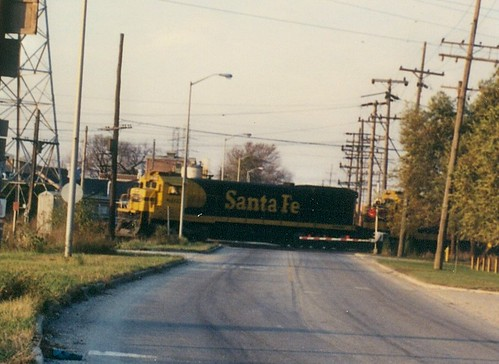 A westbound Atchison, Topeka & Santa Fe freight train crossing South Lawndale Avenue.  Mc Cook Illinois.  November 1989. by Eddie from Chicago