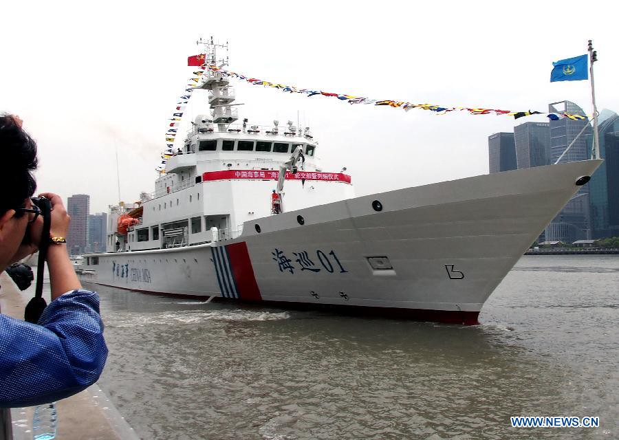 Patrol vessel Haixun 01 makes sail from a port in Shanghai, east China, April 16, 2013. Haixun 01, officially delivered and put into service Tuesday and managed by the Shanghai Maritime Bureau, is China's largest and most advanced patrol vessel. The 5,418-tonnage Haixun01 is 128.6 meters in length and has a maximum sailing distance of 10,000 nautical miles (18,520 km) without refueling. It will carry out missions regarding maritime inspection, safety monitoring, rescue and oil spill detection and handling. [Photo: Xinhua/Chen Fei]