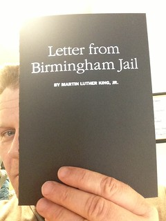 "Trent Gilliss Holds a Copy of MLK's ""Letter from Birmingham Jail"""