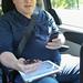 Glenn Multitasking in the Van by Jeff Carlson