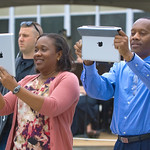 13cmc18 -- Joann Creary (left), older sister to graduate Lauren Rock, and Terry Rock (right), Lauren's father, use their iPads to get graduation photos.