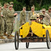 Seabees race in hand crafted banana box car. by Official U.S. Navy Imagery