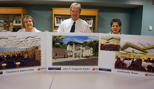 (L to R) Anne Hogya, Pittston Library Director , Thomas Williams, USDA Rural Development State Director, and Barbara Quinn, Library Board President, display artist renderings of the library expansion slated to begin this summer. USDA photos.