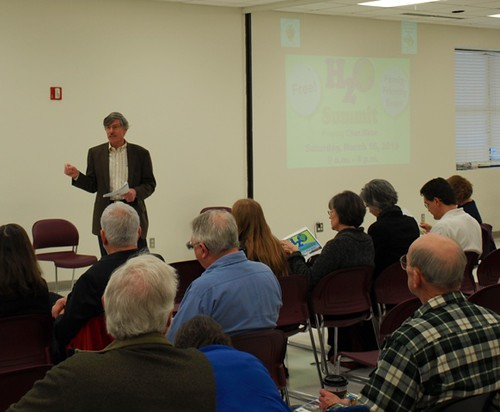 Image of DEP Director, Bob Hoyt, speaking to a crowd of residents, nonprofits and business leaders.