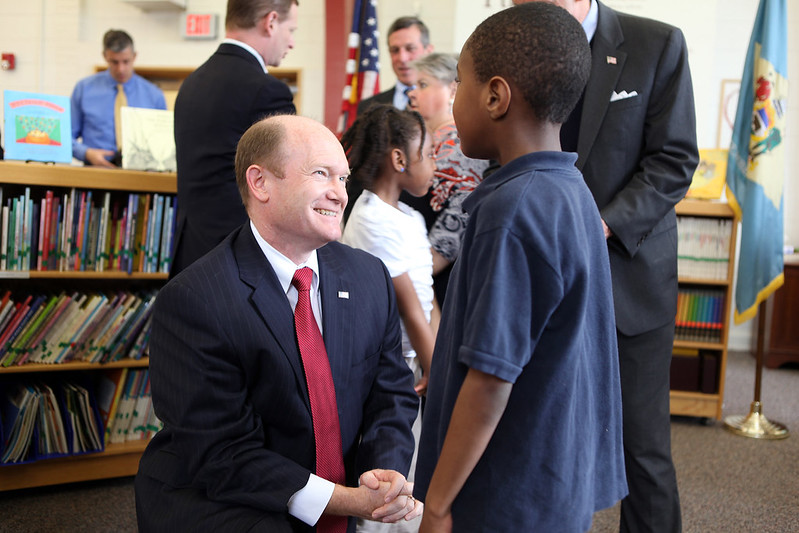 Photo of Senator Chris Coons with a young student