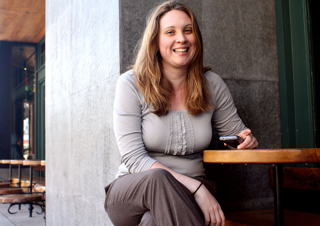Stephanie May, creator of a San Francisco Rental Heat Map that lists the median prices of a one-bedroom for each district, sits in front of a cafe on Tuesday, April 16, 2013. Photo by Gabriella Gamboa / Xpress