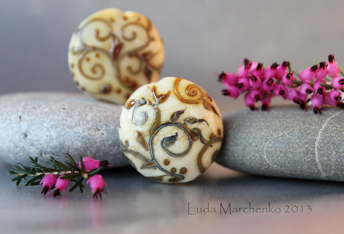 A pair of ivory beads