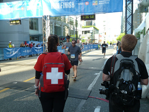 Crossing the finish line of the Vancouver Half Marathon