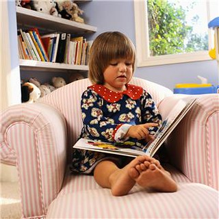 3 year old girl reading a book