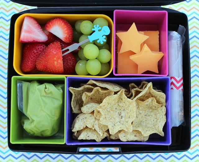 Laptop Lunches bento box lunch - multigrain tortilla chips, guacamole, cheddar cheese, organic strawberries, grapes & homemade granola bar