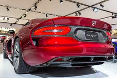 automobile(1.0), automotive exterior(1.0), exhibition(1.0), executive car(1.0), wheel(1.0), vehicle(1.0), performance car(1.0), automotive design(1.0), auto show(1.0), bumper(1.0), land vehicle(1.0), luxury vehicle(1.0), srt viper(1.0), supercar(1.0), sports car(1.0),