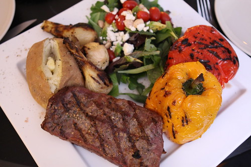 Grilled Flank Steak, Baked Potato, Grilled Spring Onions, Bell Peppers, and Salad