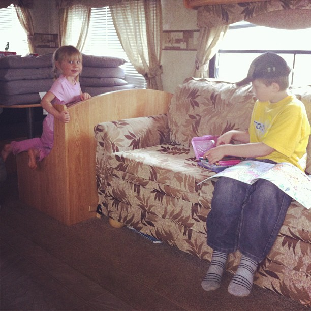 Back to the trailer to get it opened and cleaned out! Kids were thrilled to find last year's colouring books. ;) #easytoplease #camping #cmig365apr