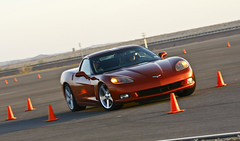 """Students were able to enjoy a """"hot pass"""" to sit passenger in a Chevy Corvette on the Autocross route"""
