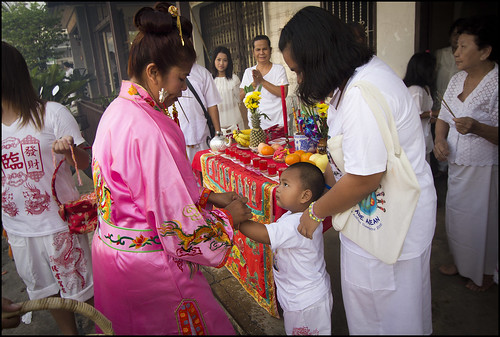 Ma Song blessing a small boy in Kathu village, Phuket