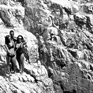 Image de Praia da Conceição. beach candid rocks girls photographing selfie blackandwhite black white bw creativecommons cc