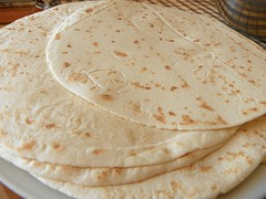 bread(0.0), gã¶zleme(0.0), pupusa(0.0), roti prata(0.0), ciabatta(0.0), quesadilla(0.0), naan(0.0), bazlama(0.0), roti canai(0.0), flatbread(1.0), paratha(1.0), tortilla(1.0), baked goods(1.0), food(1.0), piadina(1.0), dish(1.0), roti(1.0), cuisine(1.0), chapati(1.0),