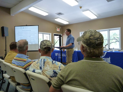 The leaders of SMARRT look on as Dr. Karl Havens presents the Apalachicola Bay Oyster Task Force's report.
