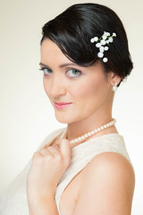 bride(0.0), veil(0.0), bridal veil(0.0), long hair(0.0), black hair(1.0), face(1.0), hairstyle(1.0), clothing(1.0), head(1.0), jewellery(1.0), hair(1.0), photo shoot(1.0), headpiece(1.0),