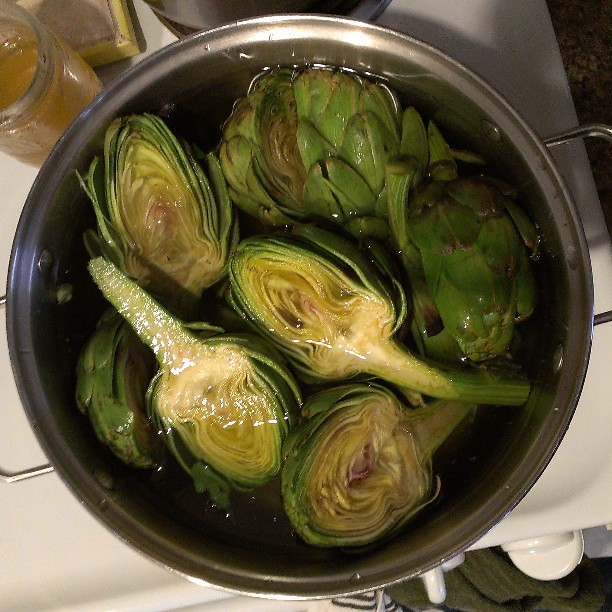 "cooked up fresh artichokes before the they had a chance to go bad, this time. the farmer I bought them from said to just wash, chop in half, and boil with some garlic and lemon. ""those elaborate Internet instructions for artichokes make me sick!"" she said"