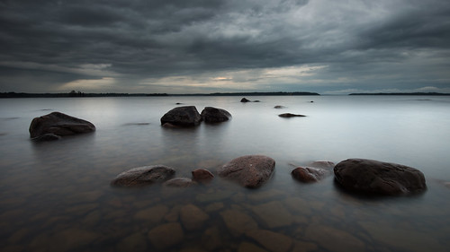 longexposure morning lake seascape nature water clouds sunrise dark landscape dawn early lowlight nikon rocks gloomy cloudy sweden outdoor stones gray may le fx dim 169 colorless dull vänern rainclouds d800 hammarö colourless värmland 1635 1635mm lakescape fiskevik widecrop 2013 2exposures bonäsudden manualblend fiskvik manuallyblended davidolsson räggårdsviken 1635vr