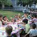Kodachrome memories of times gone by. My sister's 8th birthday party in our back yard. The kids table gets Penguin Cola in steel cans and plates of potato chips. The adult table looks to be engaged in serious conversation. MIlford Conecticut. July 2 1970. by wavz13