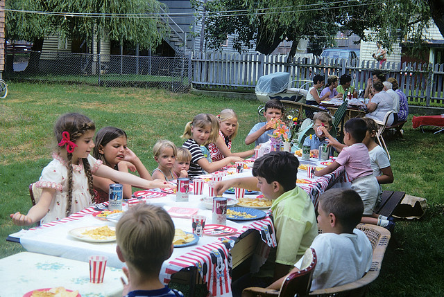 Kodachrome memories of times gone by. My sister's 8th birthday party in our back yard. The kids table gets Penguin Cola in steel cans and plates of potato chips. The adult table looks to be engaged in serious conversation. MIlford Conecticut. July 2 1970.