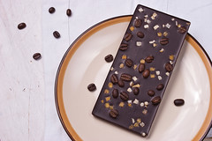 Chocolate with zest and coffee beans on the white…