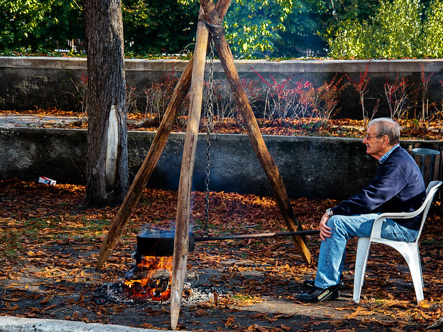 Man cooking roast chestnuts beside the road