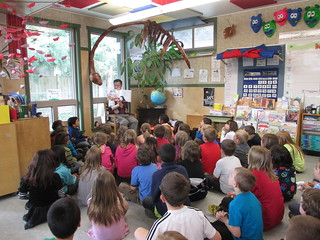 Alan Woo reading to grade 1 & 2 students at Penfield Elementary in Campbell River