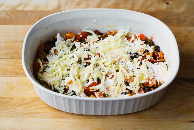 Sprinkle Mozzarella cheese over sour cream and roasted veggies