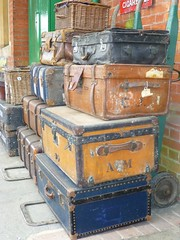 furniture(0.0), chest of drawers(0.0), chest(0.0), wood(1.0), baggage(1.0), trunk(1.0), antique(1.0), suitcase(1.0),