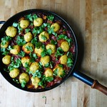 Chickpea flour dumplings with yellow peppers in tomato sauce