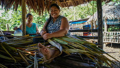 Samoan woman weaving her family's mat using dried coconut leaves. Apia,Samoa