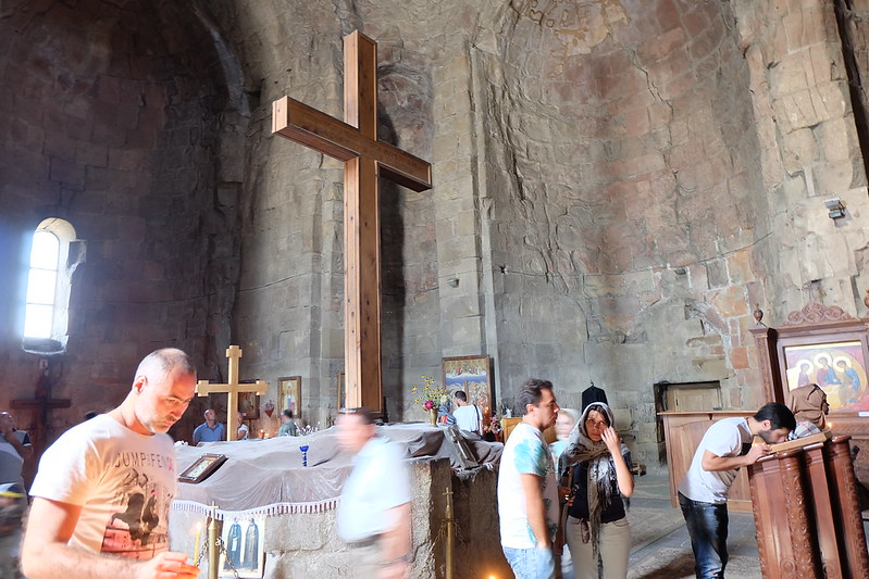 Some of the tourists pray inside the Jvari church