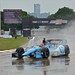 Simon Pagenaud runs in the rain