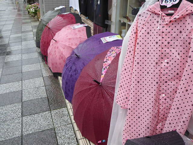 Umbrellas and raincoats for sale