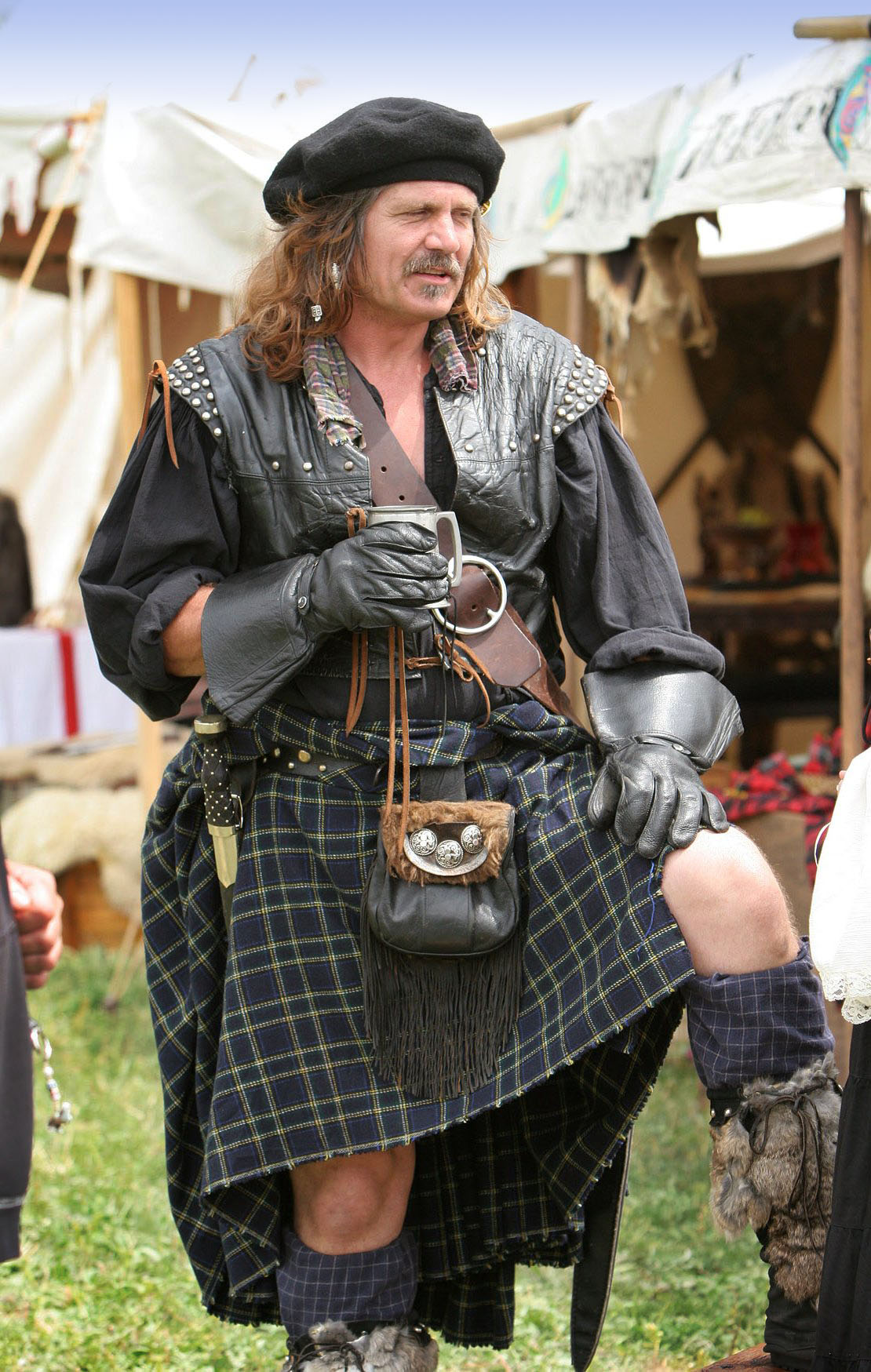 A belted plaid with sporran as worn by a reenactor of Scottish history.