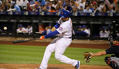 The Mets' James Loney makes contact in the second inning.