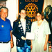 North Raleigh member Katie Turnbull was a Rotary Youth Exchange participant during her senior year. She missed her school's graduation ceremony that year so her sponsoring Rotary club held a ceremony at their lunch meeting. Katie is holding her diploma.  Q&A from Scott Tarkenton and Katie Turnbull  Where was this taken? Tunkhannock Rotary club's regular lunch meeting (district 7410)  When was this taken? June or July 1998  Names of those with you in the photograph? David Whipple (Rotary), me, Sandy Miller (school board), and John Gallo (high school principal)  Where did you go as an exchange student? Zaragoza, Spain