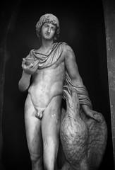art model(0.0), figure drawing(0.0), monument(0.0), bodybuilding(0.0), art(1.0), arm(1.0), chest(1.0), classical sculpture(1.0), sculpture(1.0), male(1.0), mythology(1.0), man(1.0), muscle(1.0), monochrome photography(1.0), nude photography(1.0), monochrome(1.0), black-and-white(1.0), statue(1.0),