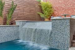 Glass Tile Spa with Negative Edge and Precast Coping