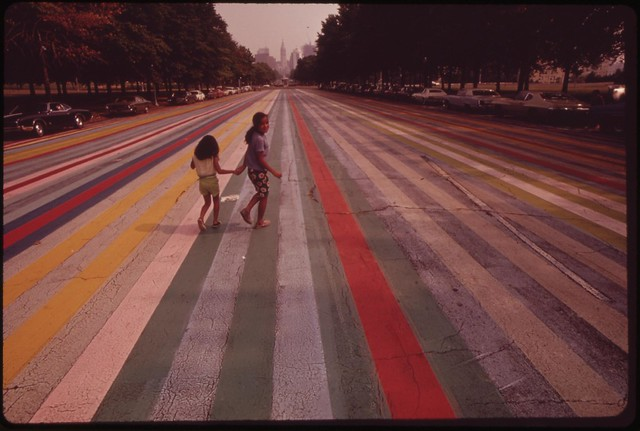 DOCUMERICA: Crossing The Painted Road Which Extends East From The Philadelphia Museum Of Art, August 1973 by Dick Swanson.