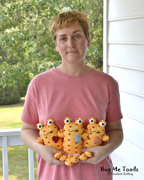 Orange Hug Me Sock Toads with polka dots, original art toy by Elizabeth Ruffing, also pictured
