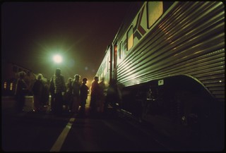 Amtrak passengers board the southbound san diegan as it makes a nighttime stop at the Fullerton, California, station, May 1974