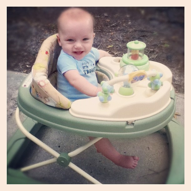 Something I love to have for baby: a walker!! His feet don't touch yet, but wait til they do!!!
