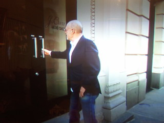 Mickey Drexler trying to open a door